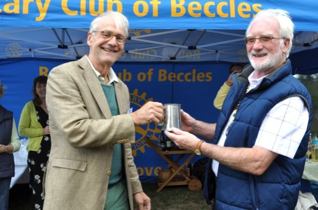 The exchange of the travelling tankard between Peter Hustinx and the Beccles club president Paul Randle, as